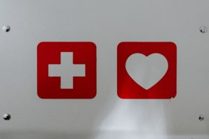 red cross and heart on white