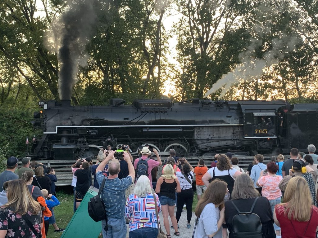 Steam engine 765 in front of a large crowd of people